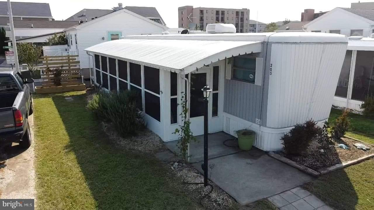 Large Corner Lot Location with Extra Parking in this well maintained desirable Community of Isle of Wight Park, Bayside between 24th & 25th Streets. Just 2 blocks from the Beach & Boardwalk. Close to Fine dinning, Miniature Golf, Fishing, Crabbing & Clamming. This unit is a Vintage Spartan Imperial Mansion  Recreational Vehicle that features a large porch addition with new outdoor furniture and sleeps 6 comfortably. 2 New Split Wall Units in 2018 with 10 Year Warranty that Conveys. Re-Coated Roof in 2019, New Vinyl Flooring, New Refrigerator in 2018 and New Porch Blinds & Screen in 2020. Don't Delay Call Today!