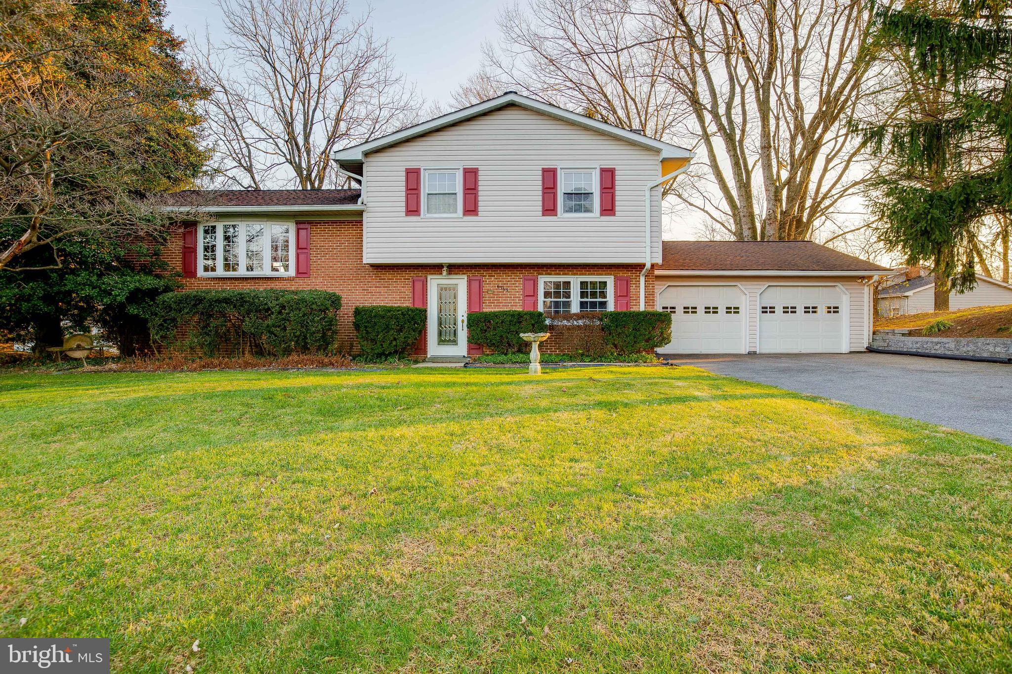 This meticulously maintained home is ready for you to call home!  Featuring hardwood floors througho