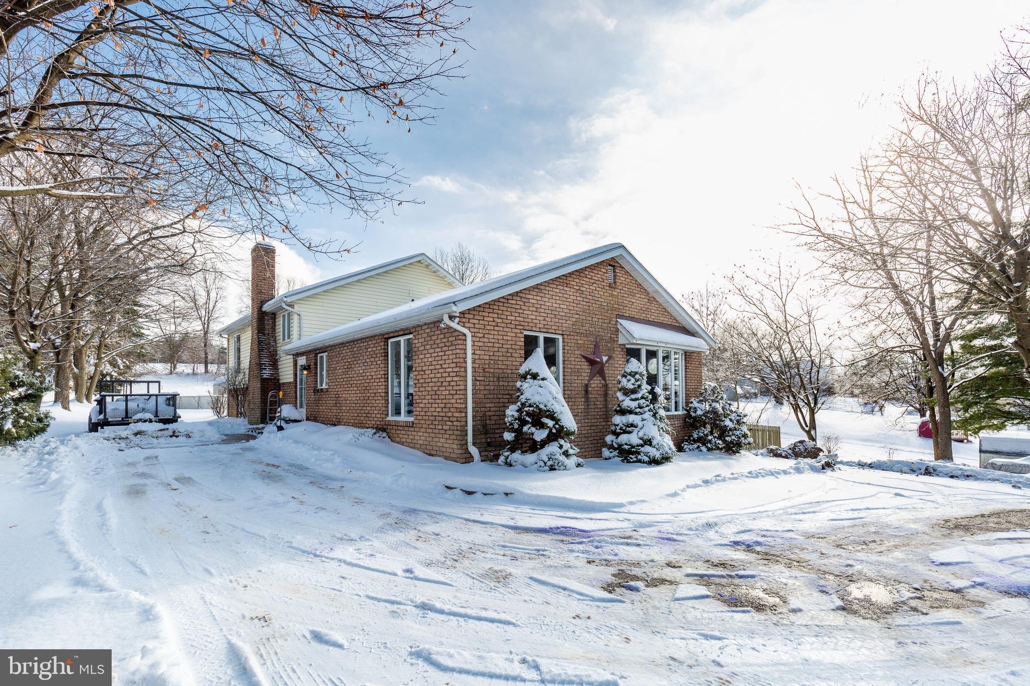 Price Improved!  Large 5 BR home, with in law suite, situated on 3/4 acre just outside Westminster C