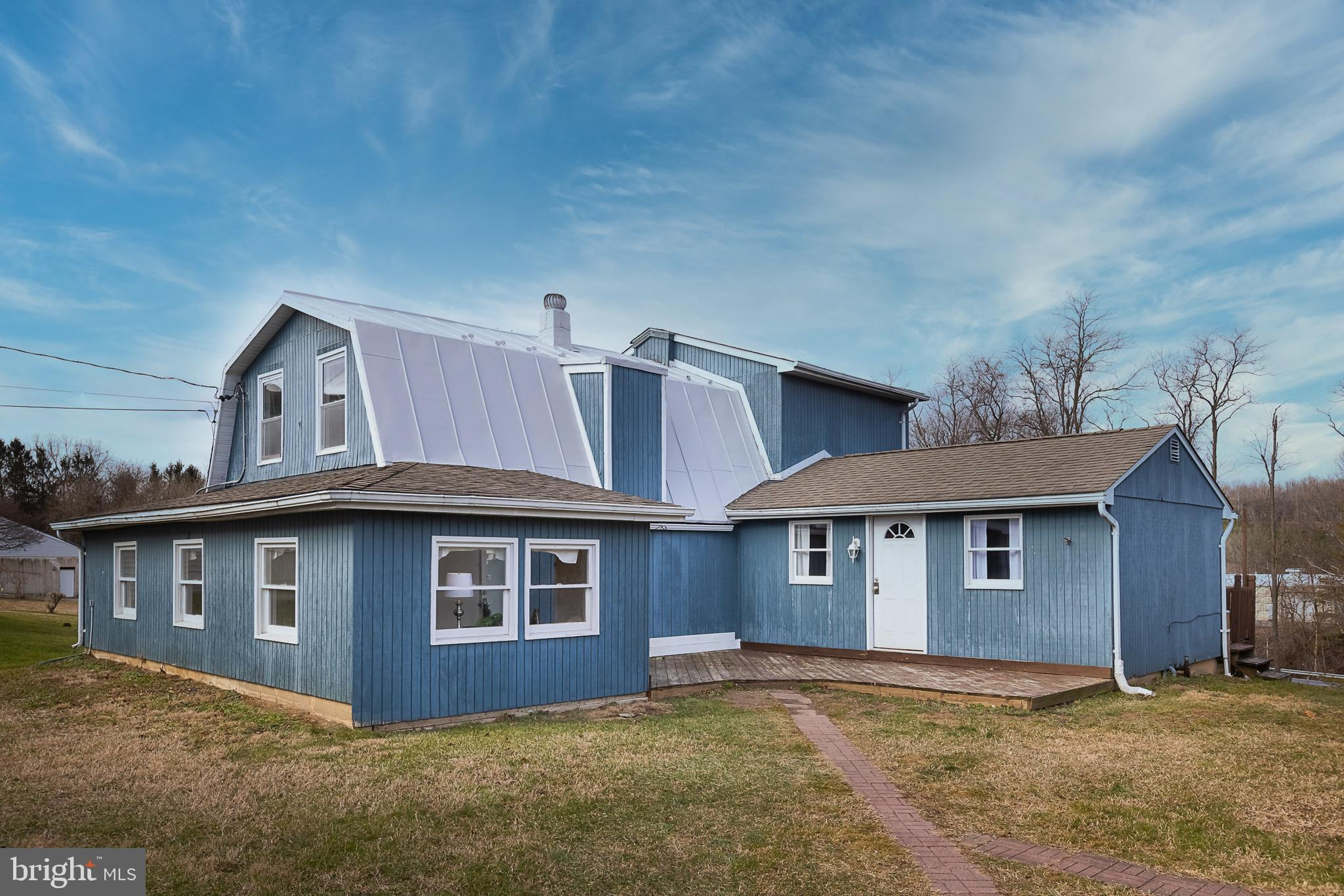 Don't let the outside fool you!  Country living with modern updates.  This spacious, remodeled farmh