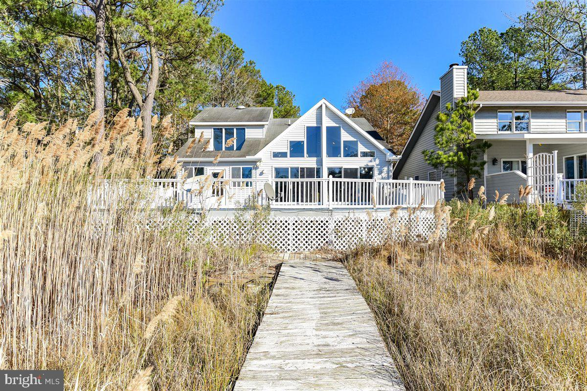 Located in the highly sought after community of Nantucket in Ocean Pines. Minutes from the Ocean City beaches by car or boat, This well kept 4 bedroom 2.5 bathroom home boasts a first floor master bedroom with its own access to the deck/pool. The floor to ceiling windows cast natural light throughout the great room with cathedral ceilings. Enjoy entertaining in the open concept kitchen with gas stove. The large deck wraps around a beautiful inground pool that overlooks the waters of Manklin Creek and The Isle of Wight Bay. Bring your boat!
