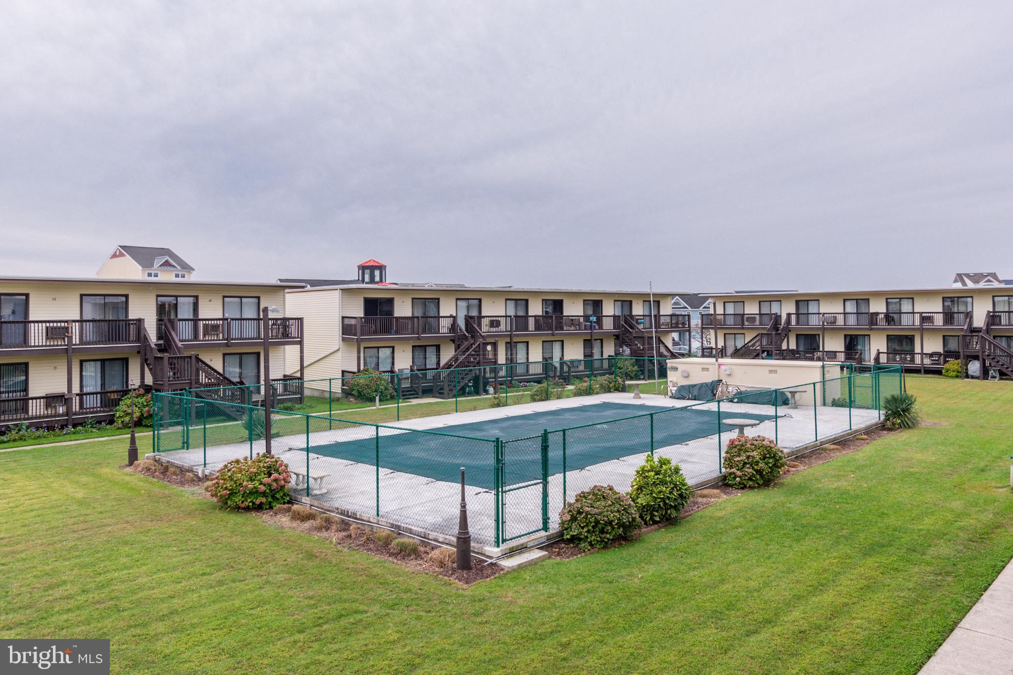 2 Bedroom Condo w/ Pool!  A non-rental with excellent rental potential.   First floor location with
