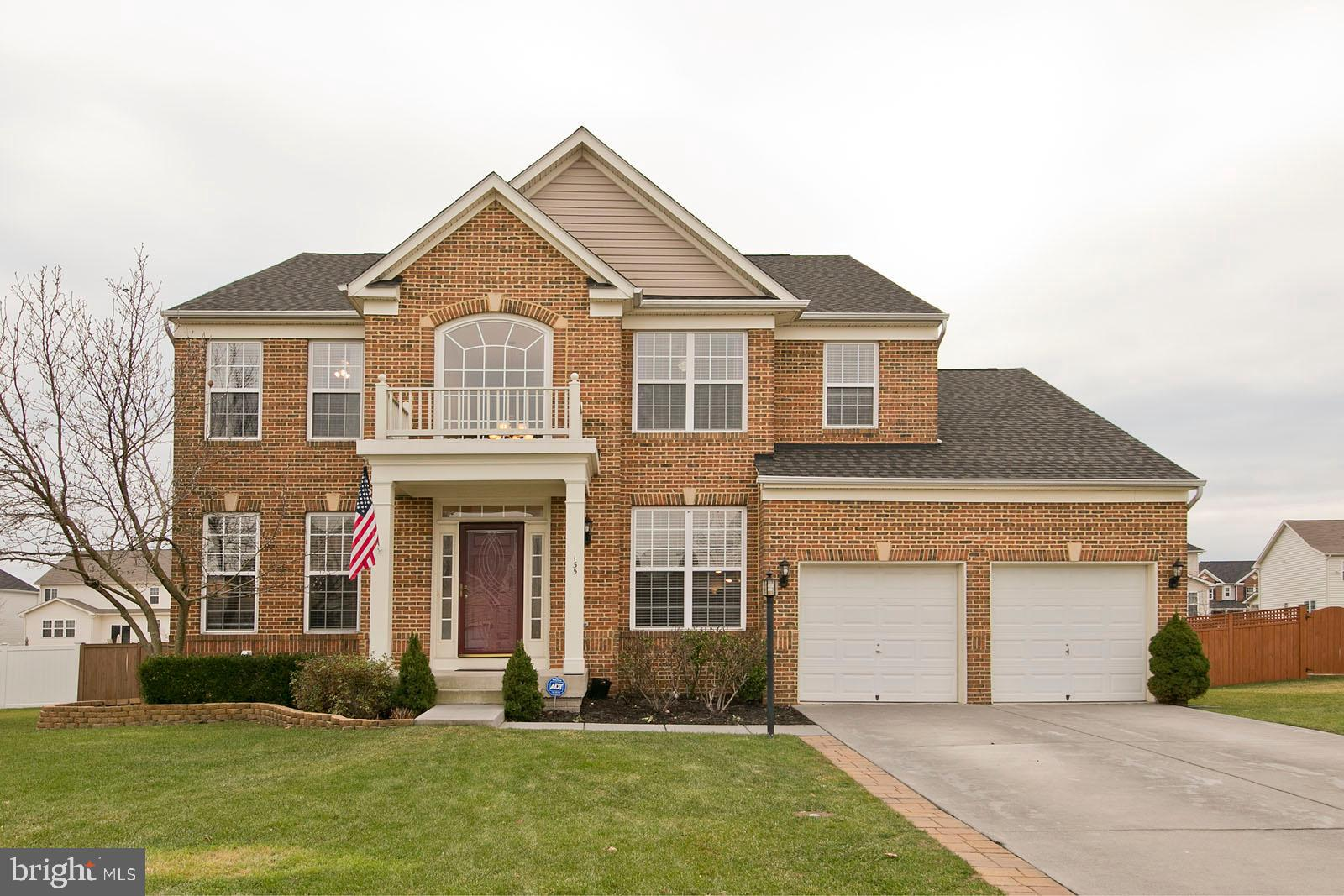 4 Bed/3.5 Bath brick front Colonial with a fenced backyard, concrete patio, and storage shed. Open f