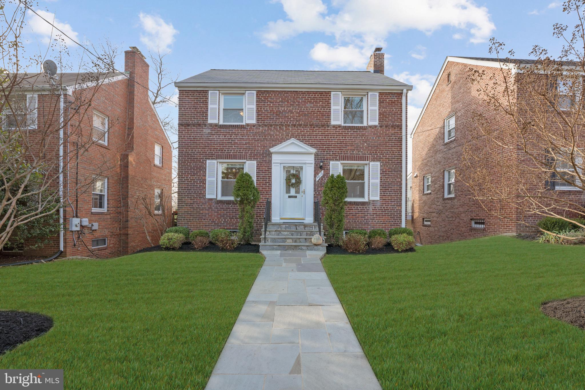Beautiful Michigan Park 3-bdrm, 2 full/2half bath home. Highlights include cook's kitchen, working fireplace, bright sun room, en-suite master, hardwood floors, walk-out basement, stone patio and off-street parking. Central air & heat. Close to Fort Totten metro & Brookland amenities.