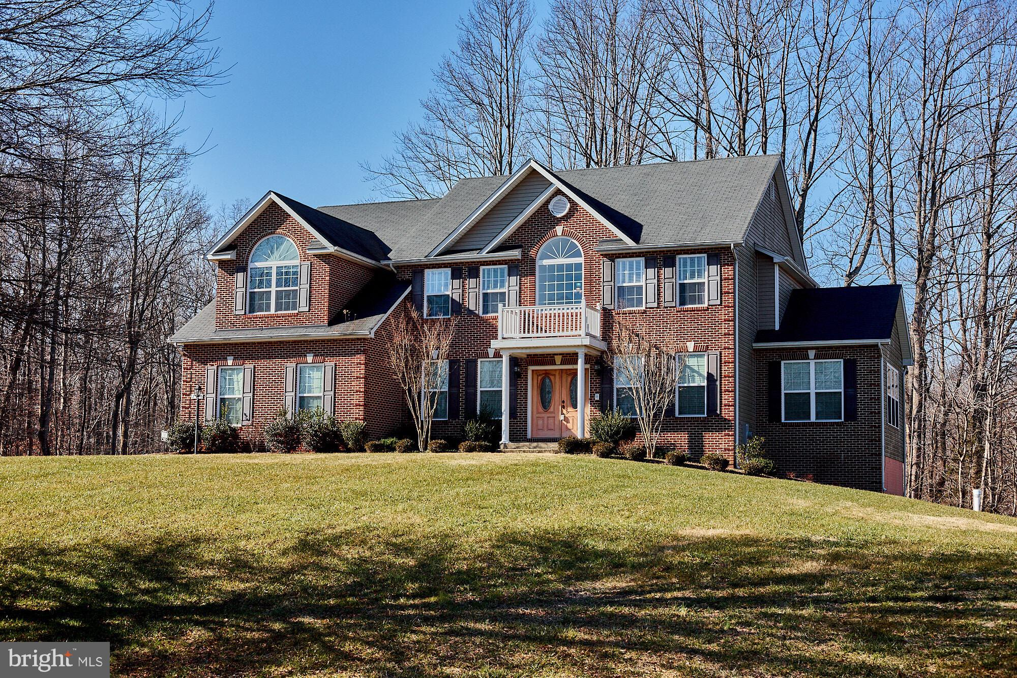 This immaculate 3-level Colonial is nestled on a quiet cul-de-sac, sitting high on 1 acre of land, i