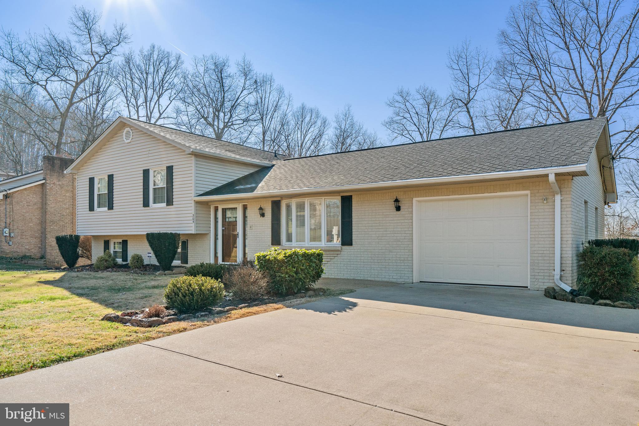 Welcome Home to 305 S Charles St, Front Royal VA.  This Beautiful Split Level Home Includes 3 Bedrooms, 3 Full Baths, Large Kitchen with Island and Granite Countertops, Dining Room, Living Room, Large Family / Recreation Room with Wood Burning Fireplace on Lower Level Along with Walkout Access to Large Backyard with Outdoor Shed.  This Home has 2,648 Sq. Ft. of Finished Living Space and Includes Hardwood Floors on Main and Upper Level; Finished Basement with Laundry Area and a 2nd Laundry Area on the Main Floor located in the Oversized 1 Car Garage.    This Home is in the Colonial Park Subdivision in beautiful Front Royal VA and Perfectly Situated on .30 Acres with Large Back Yard; Short Distance to Shopping, Restaurants, Outdoor Activities and Scenic Blue Ridge Mountains (North Entrance).  Easy Commute / Carpool / Vanpool to Northern Virginia and Washington DC using I-66.