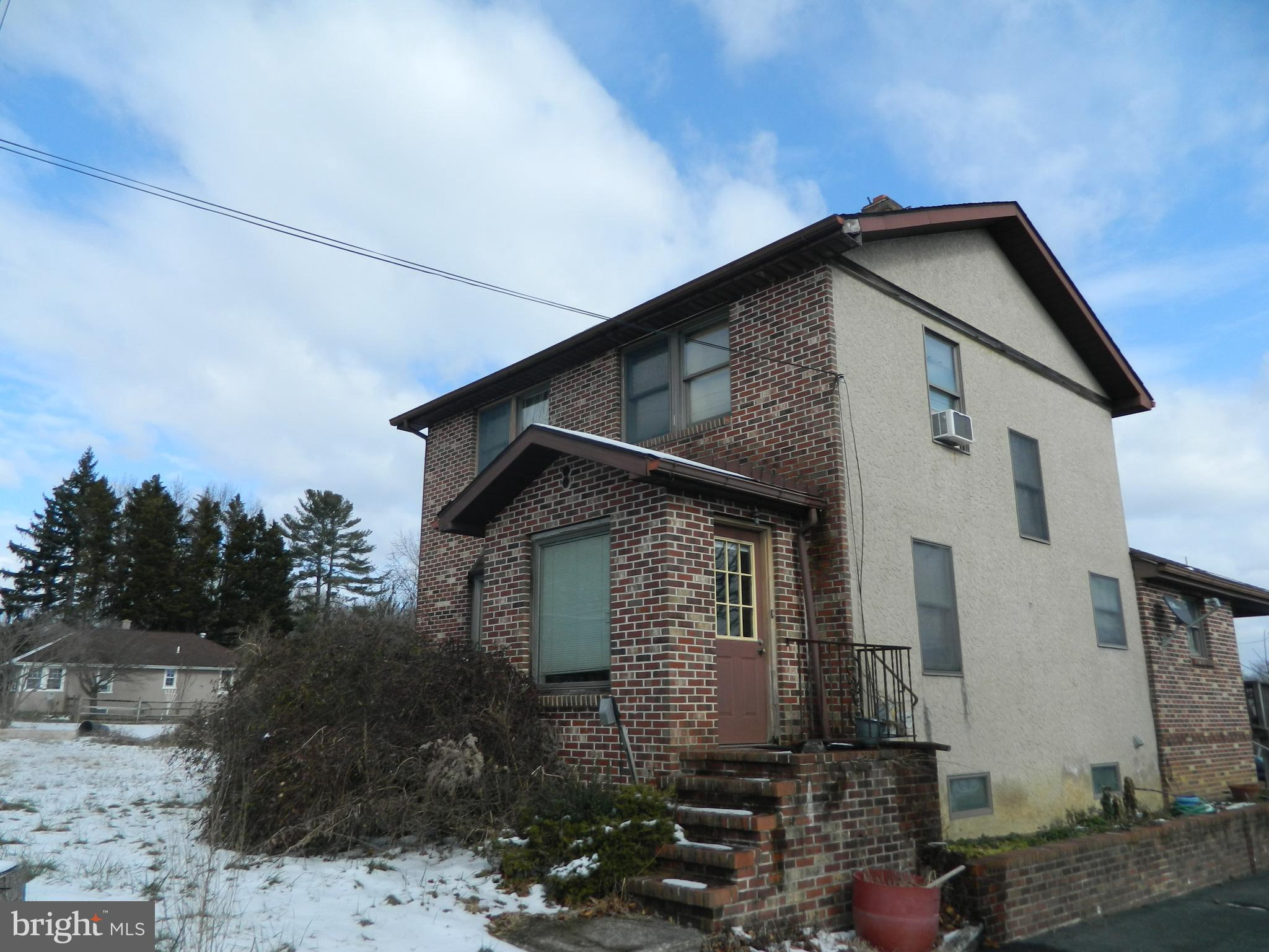 Location! Brick front, well maintained property zoned C2 for a variety of commercial uses on busy Rt
