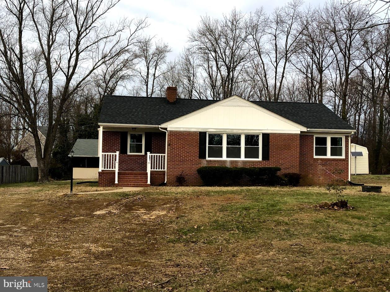 Completely Remodeled - Brick Rambler - 3 Bedrooms, 2 full baths with a full basement.  Real Hardwood