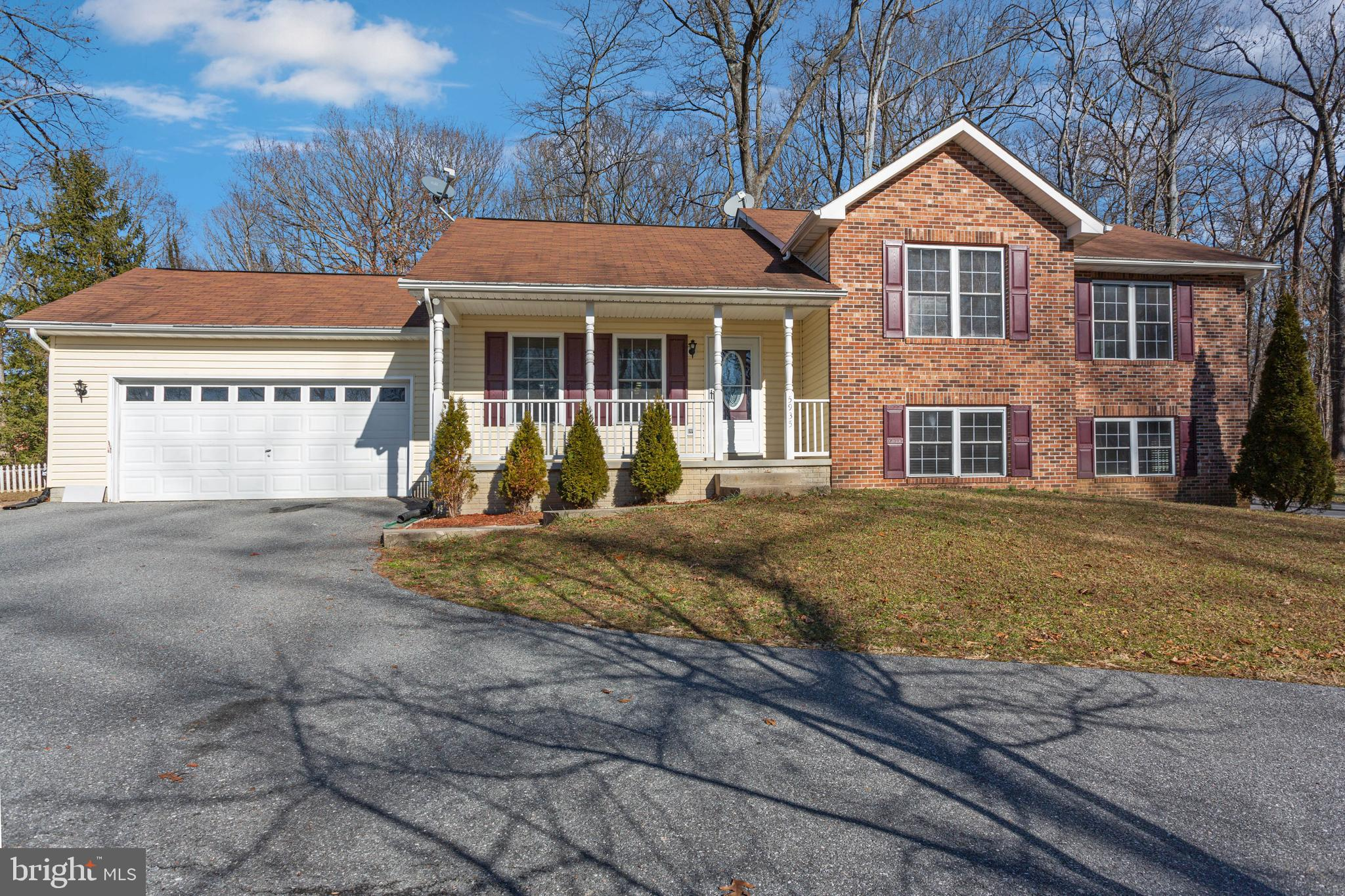 Beautiful and Large, 4 level  brick split level home on nearly a 3/4 acre quiet lot.  Updated kitche