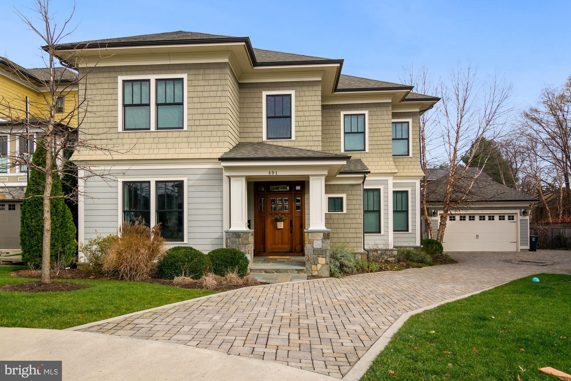 The Best of Both Worlds! Enjoy the comforts of this very spacious, high end custom home while being