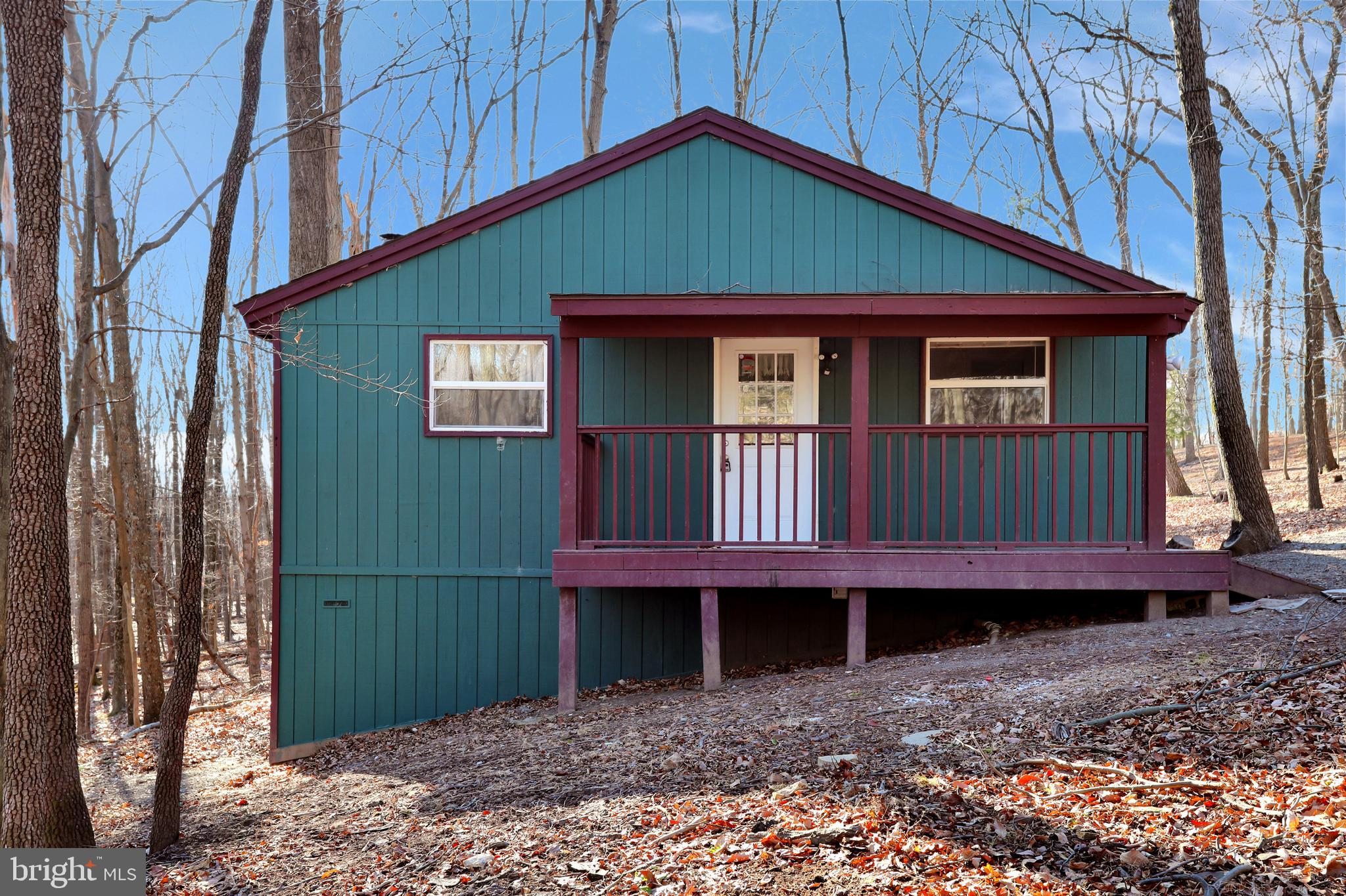 Cabin on beautiful corner lot.  Covered side porch and back screen porch compliment the two large be