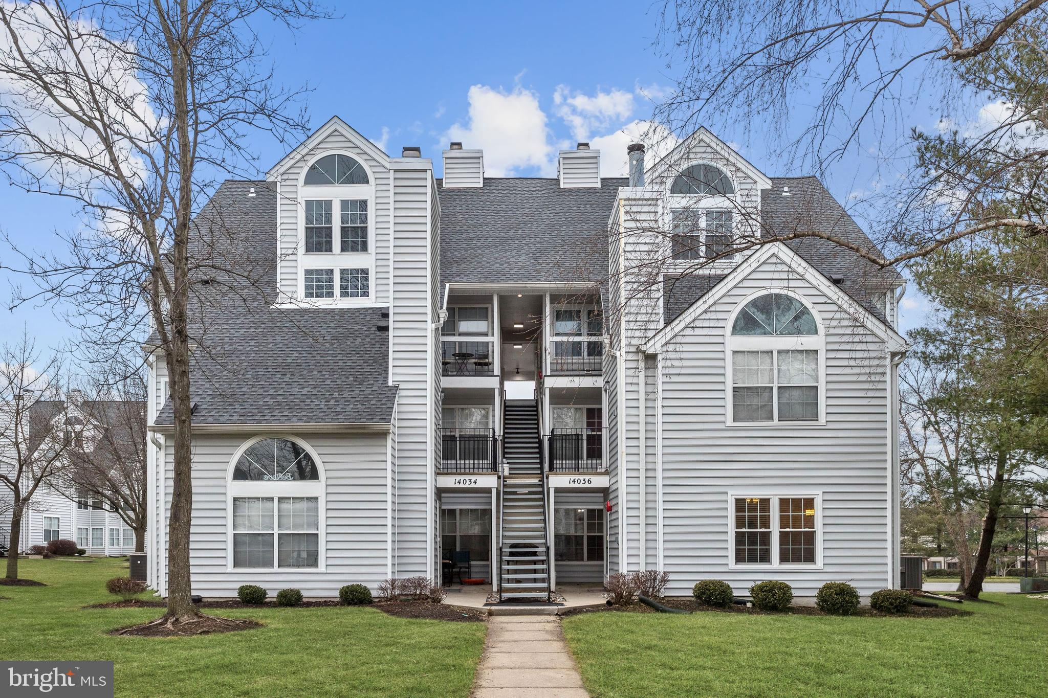 Lovely first floor condominium boasts an ideal commuter location and low-maintenance living! The ope