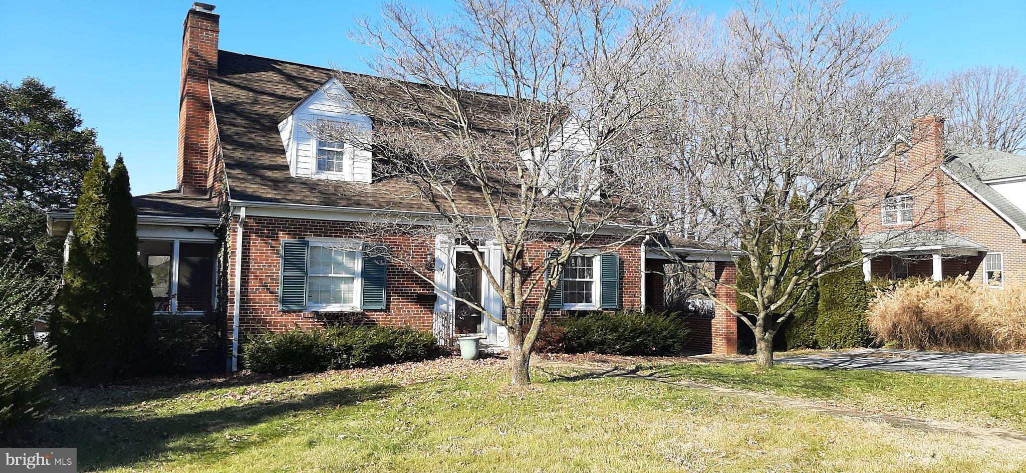 Well located Brick Cape Cod with three bedrooms, (one on the main level). Formal Living Room w/wood