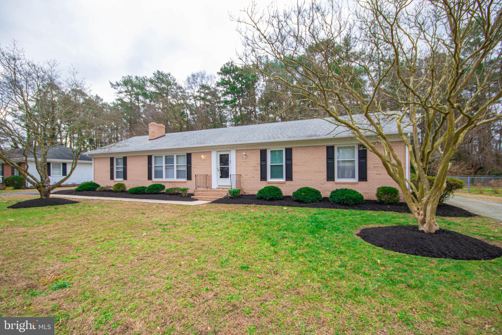 This lovely rancher has 4 bedrooms,  spacious kitchen, wood burning fireplace, paved circular drive