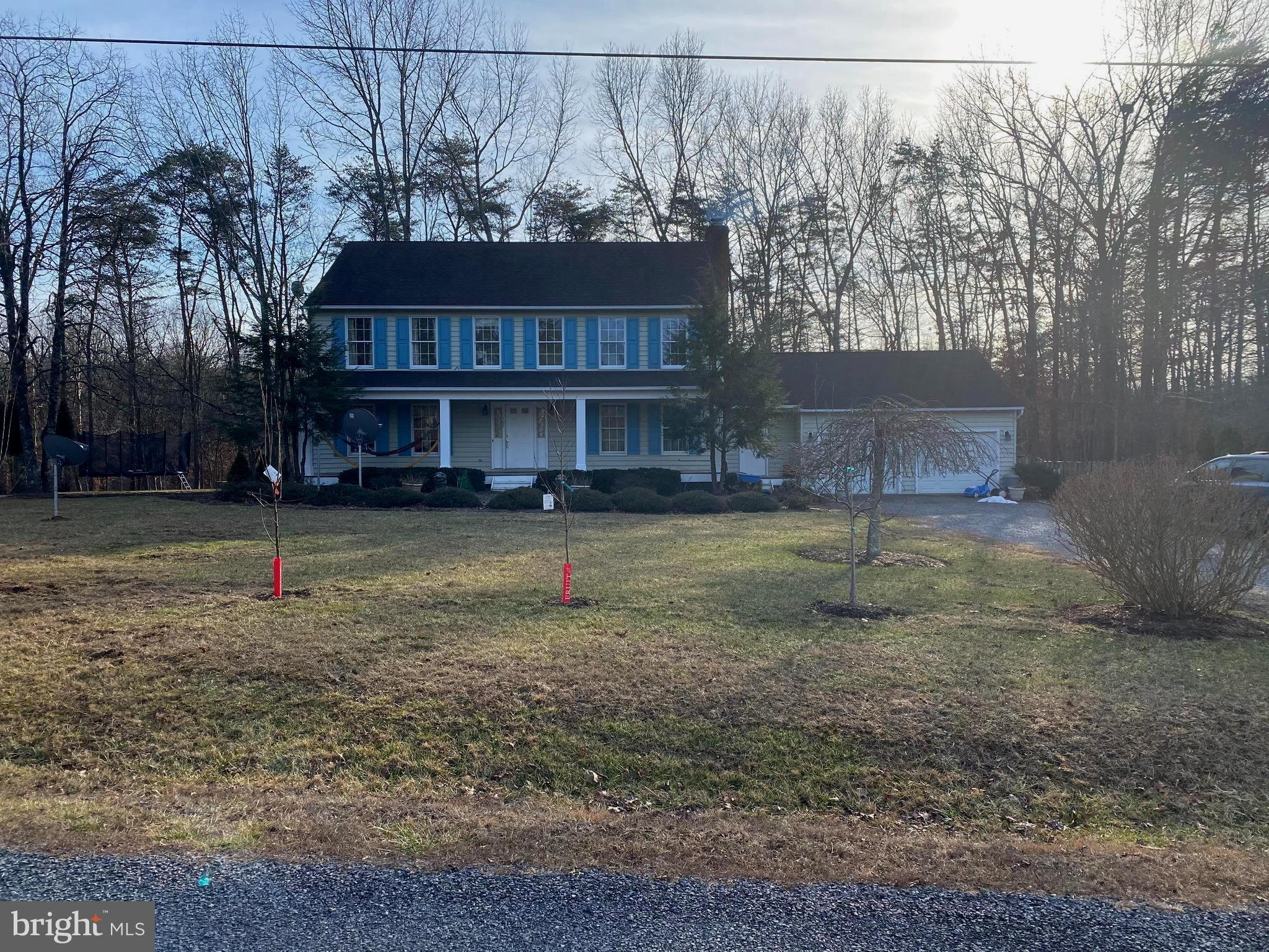 Beautiful 3 Bedroom Colonial on 5 Acres. Hardwood Floors throughout, Main Level features LivingRoom,