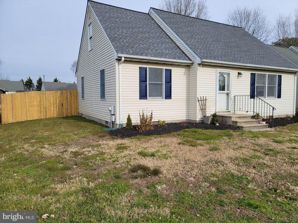 Charming, affordable Cape Cod features 2 bedrooms, 1 full bath on main level. Hardwood floors throug