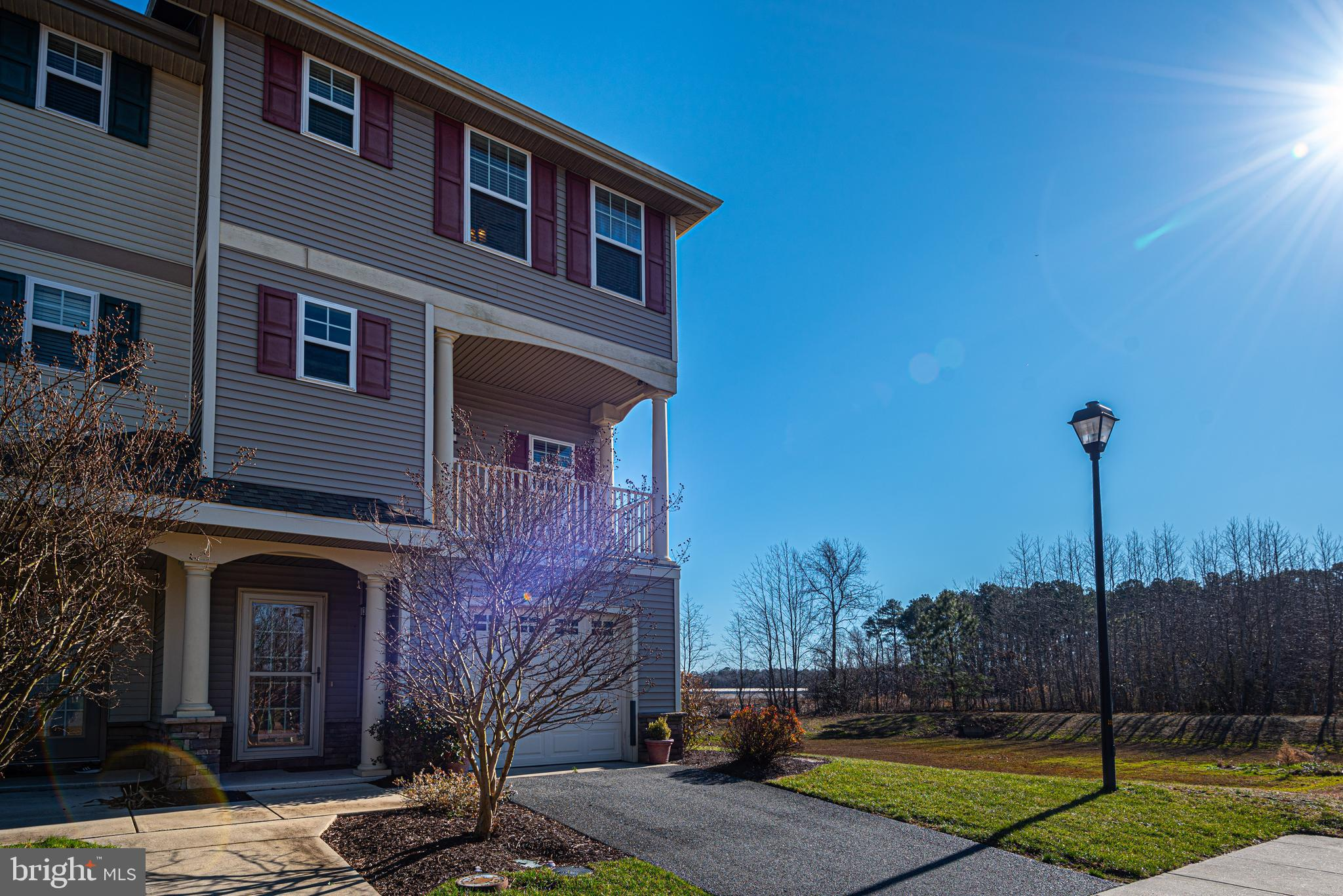 This end unit townhome - located in the community of Chapel Crossing in Dagsboro- is a short drive to the Bethany Beach area and close  to medical offices, schools, and many other conveniences.    Low maintenance living; all lawn care, exterior maintenance, master insurance, snow removal and trash collection is covered by the low condo fee of $630/quarter- as well as access to the community pool!  This unit offers the most private location within the community at the end of the street with open views of adjacent fields from the 1st floor patio and 2nd floor balconies.   The main level offers an open floor plan perfect for entertaining with corner fireplace, hardwood and tile flooring and kitchen upgrades including corian and stainless.   Entry level bedroom suite as well as 2 additional bedroom suites on the top floor.  Large closets on every level provide ample storage space.   Perfect for primary residence or second home- make this your coastal retreat today!
