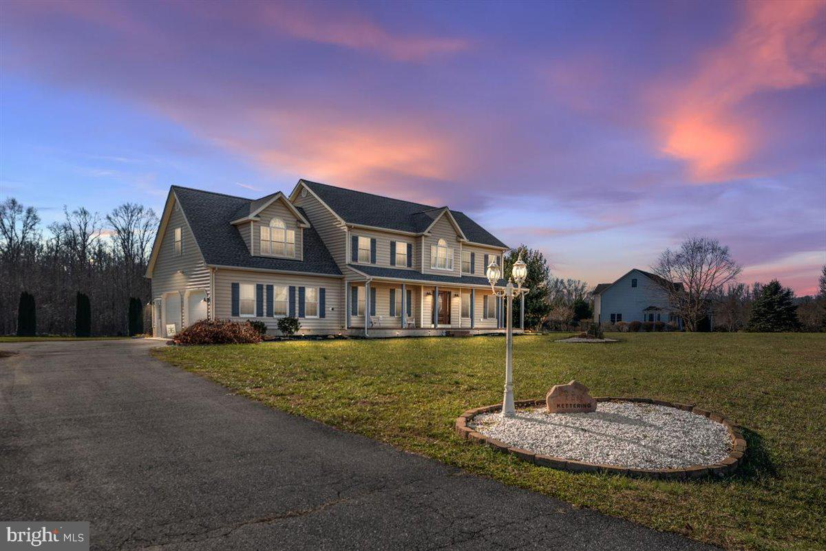 This Claiborne Fields home has it all! Sitting on a 1.3 acre lot which backs to woods and open space