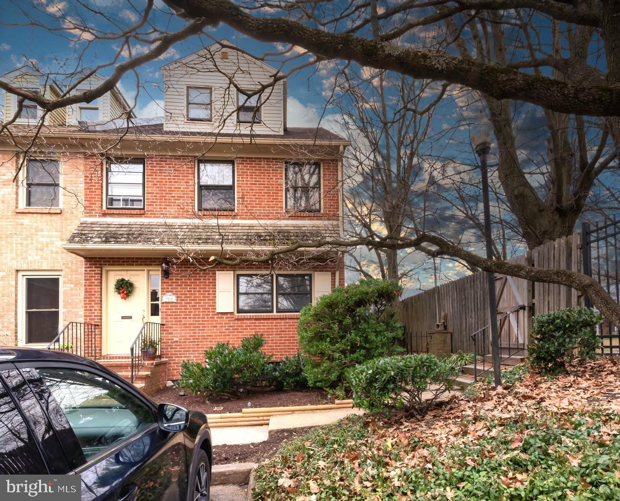 Brick beauty on N. Bancroft Parkway! Black wrought iron fence and graceful brick columns announce en