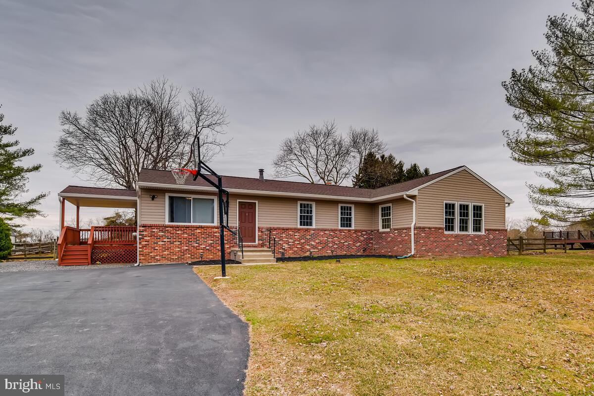 Bright and spacious rancher, completely and meticulously renovated top to bottom, inside and out, wi