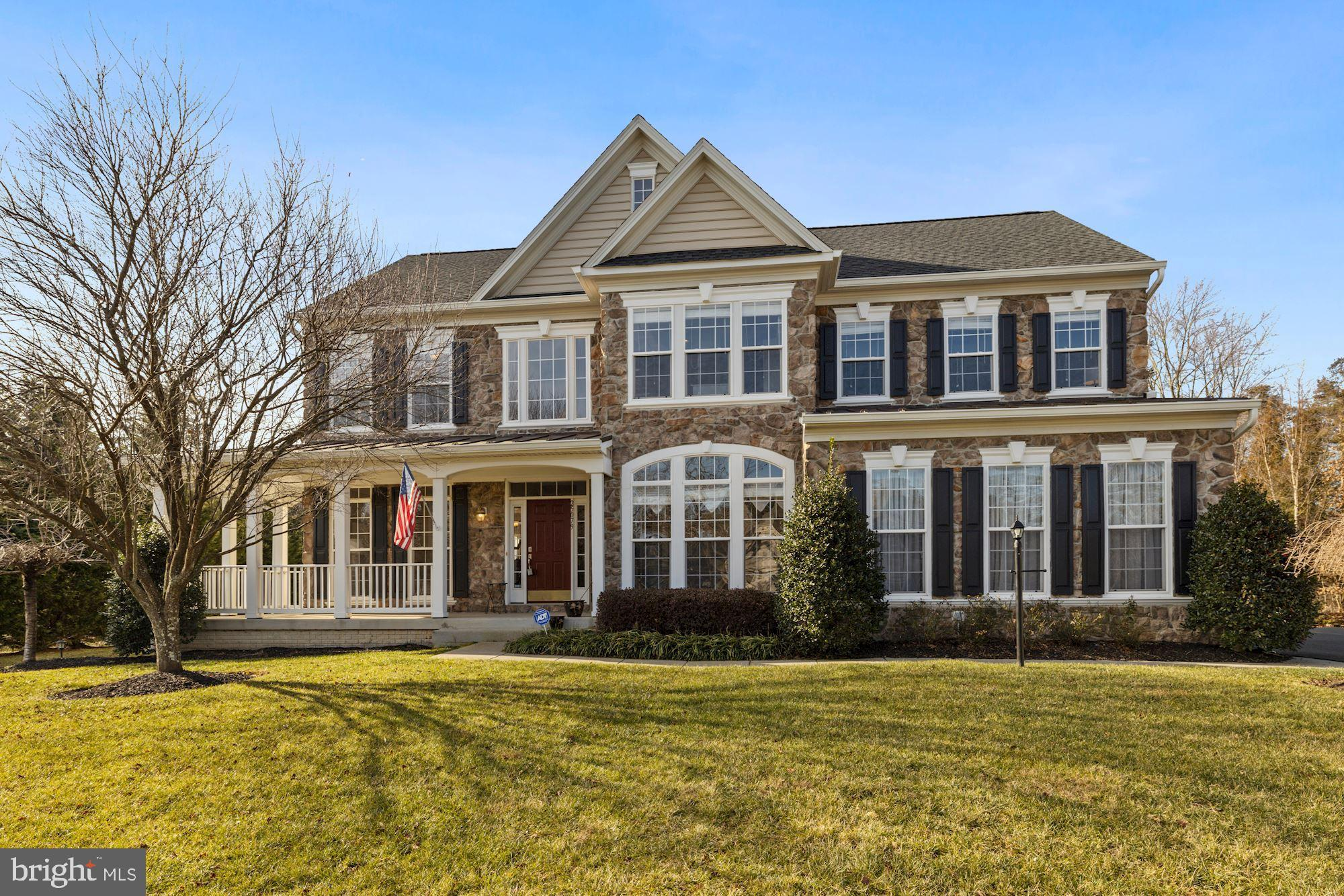 This beautiful Colonial home features a grand 2 story foyer, formal living, and dining room, plus a
