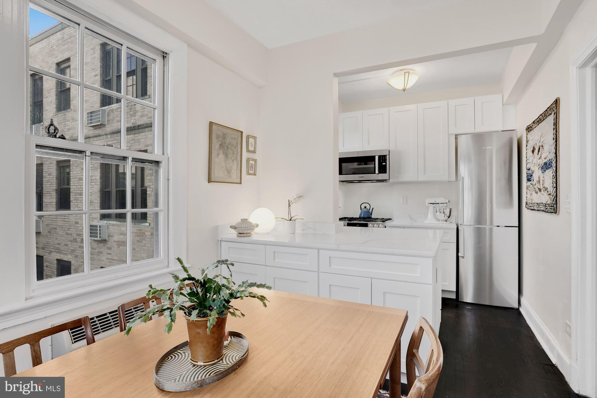 An absolute stunner, newly renovated and move-in ready! Upper floor 1 BD + den and solarium with spe