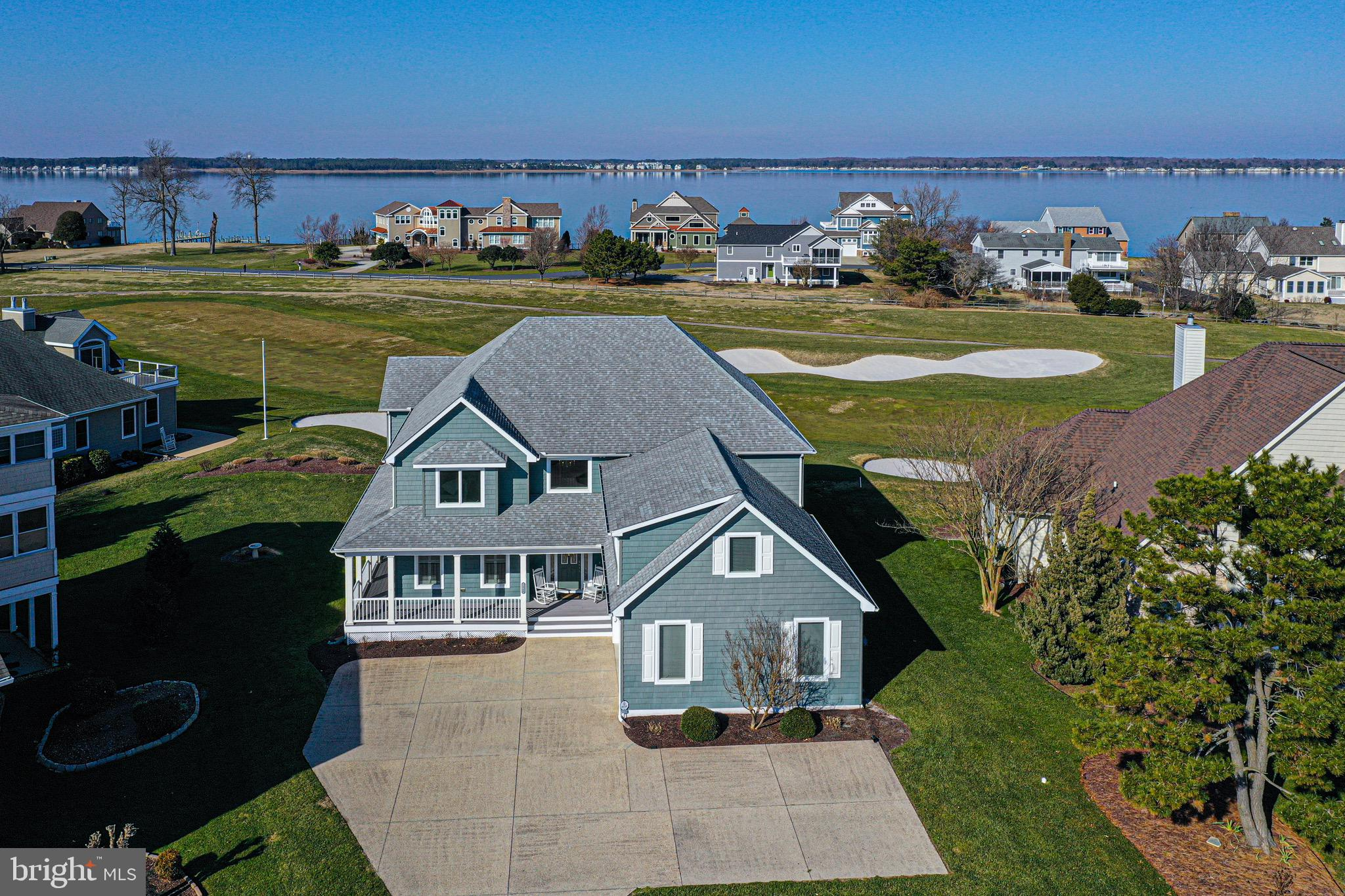 Luxury Retreat in sought after location....If breathtaking golf course and bay views are what you ar