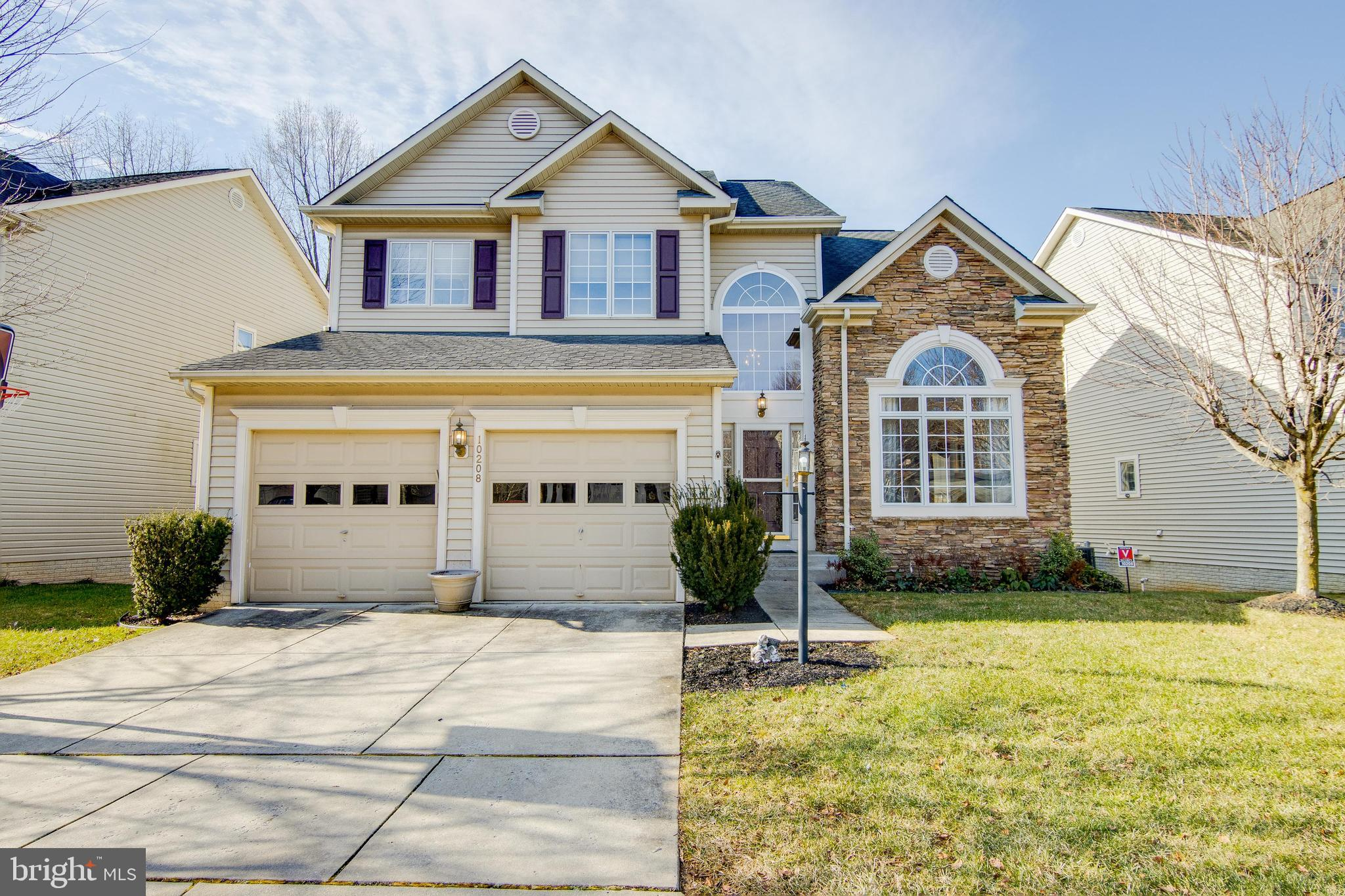 Gorgeous 5 bedroom home with tons of upgrades and backs up to common space with oversized garage wit
