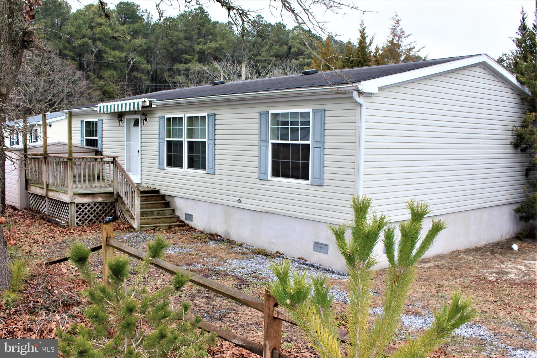 MOVE IN READY! 3 bedroom, 2  bathroom beach home one block from Indian River Bay. Fully furnished  a