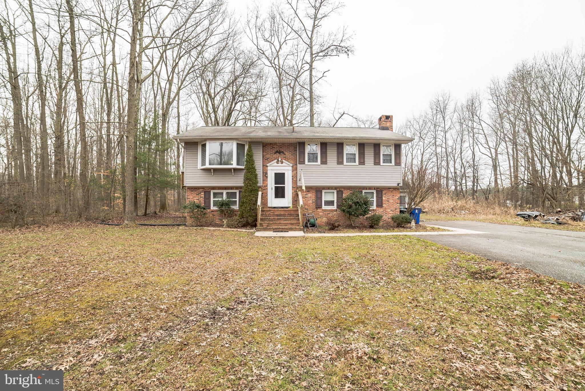Rare Opportunity to own a four bedroom split level home on 3.83 acres in Townsend, Delaware! This ho