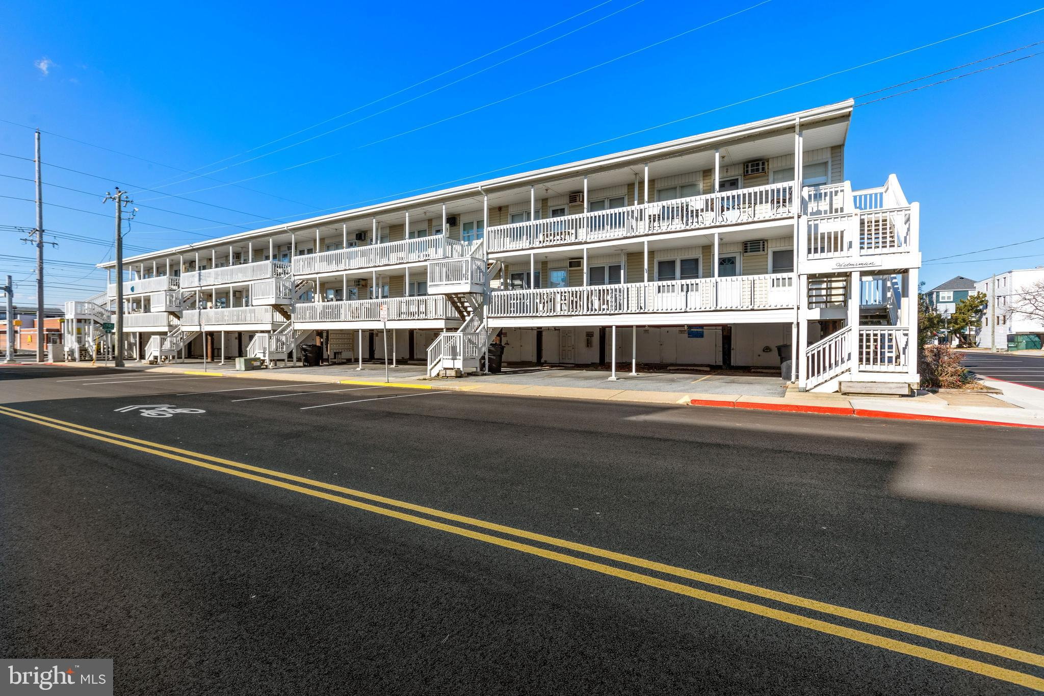 Just steps to the ocean, this coastal condominium boasts rich hardwood floors and a light filled int