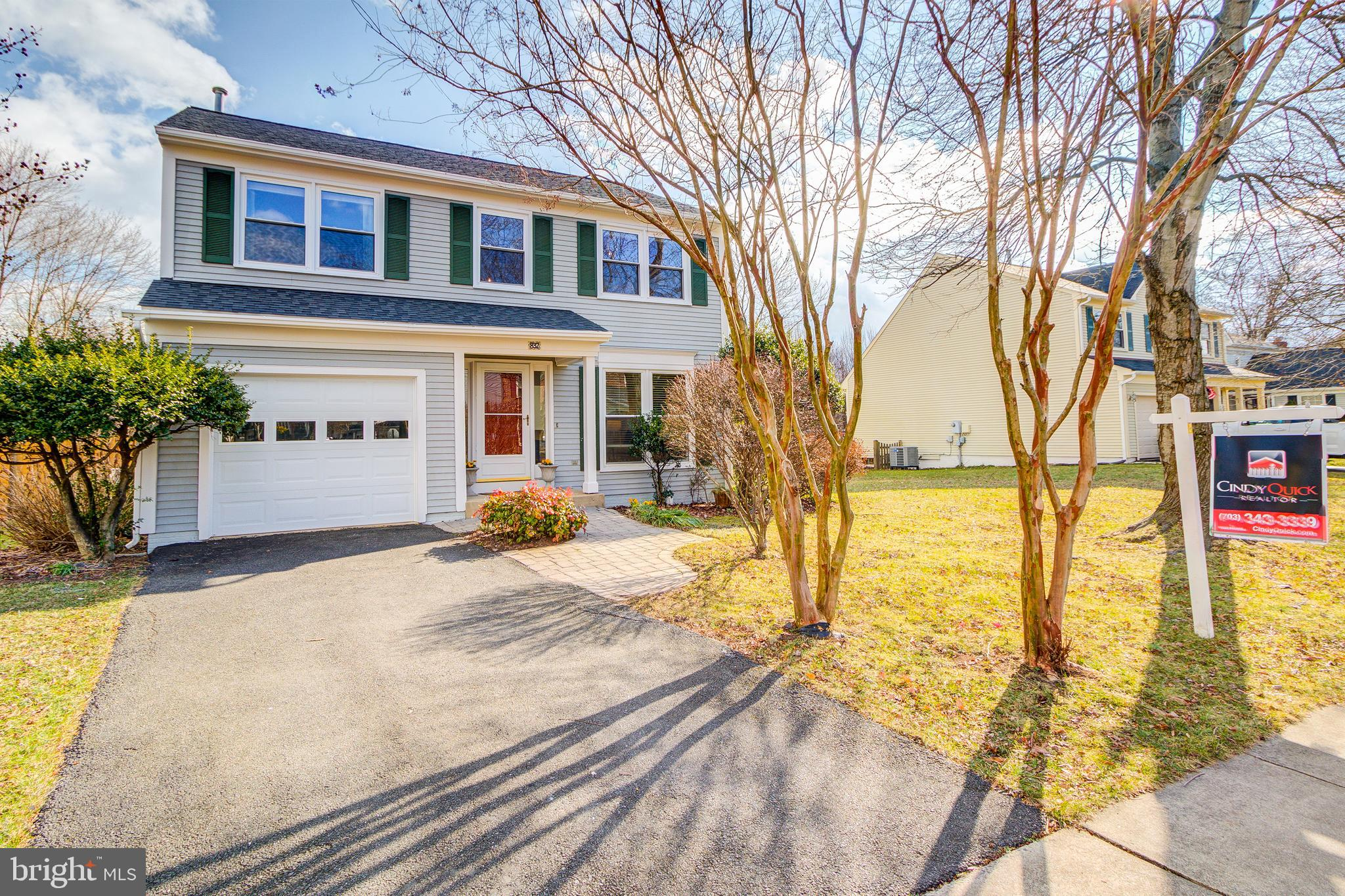 Welcome home to this well maintained, light-filled colonial backing to a large wooded common area in