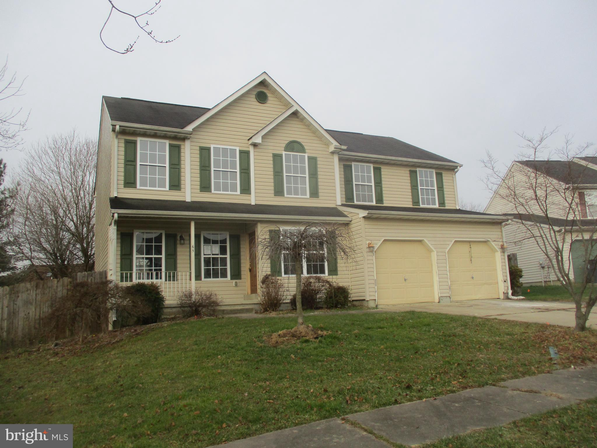 Elkton Colonial with 4 bedrooms, 2.5 baths.  Amenities include kitchen island, 2 car attached garage