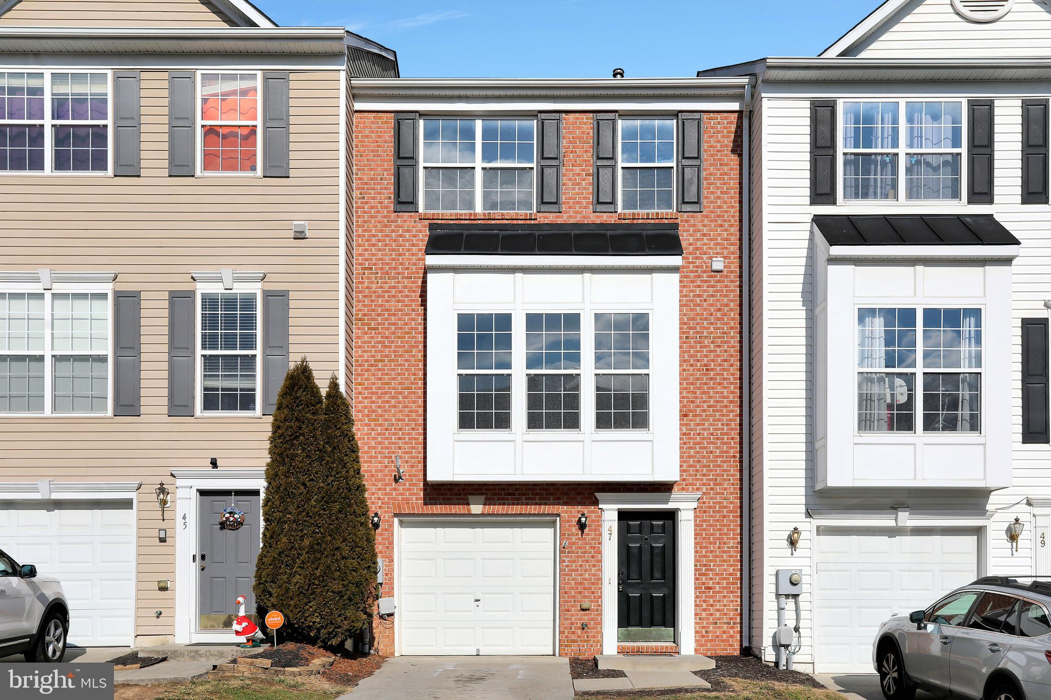 Move in ready! Three story townhouse with walkout basement offering fresh paint, new carpeting, and