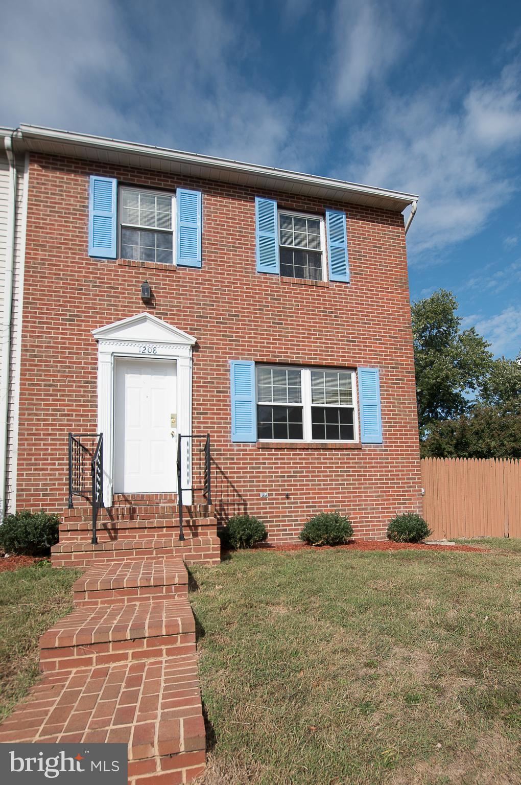 Rare Opportunity to own an End Unit Brick Townhome on a Large Fenced Lot great for family fun!  Comp