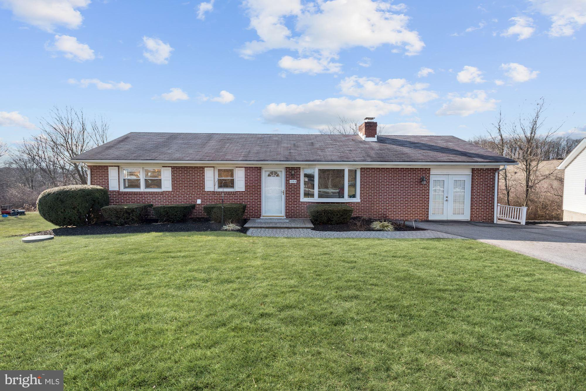 Fantastic Rancher with in-law suite and detached garage with lower level workshop!  Living room with