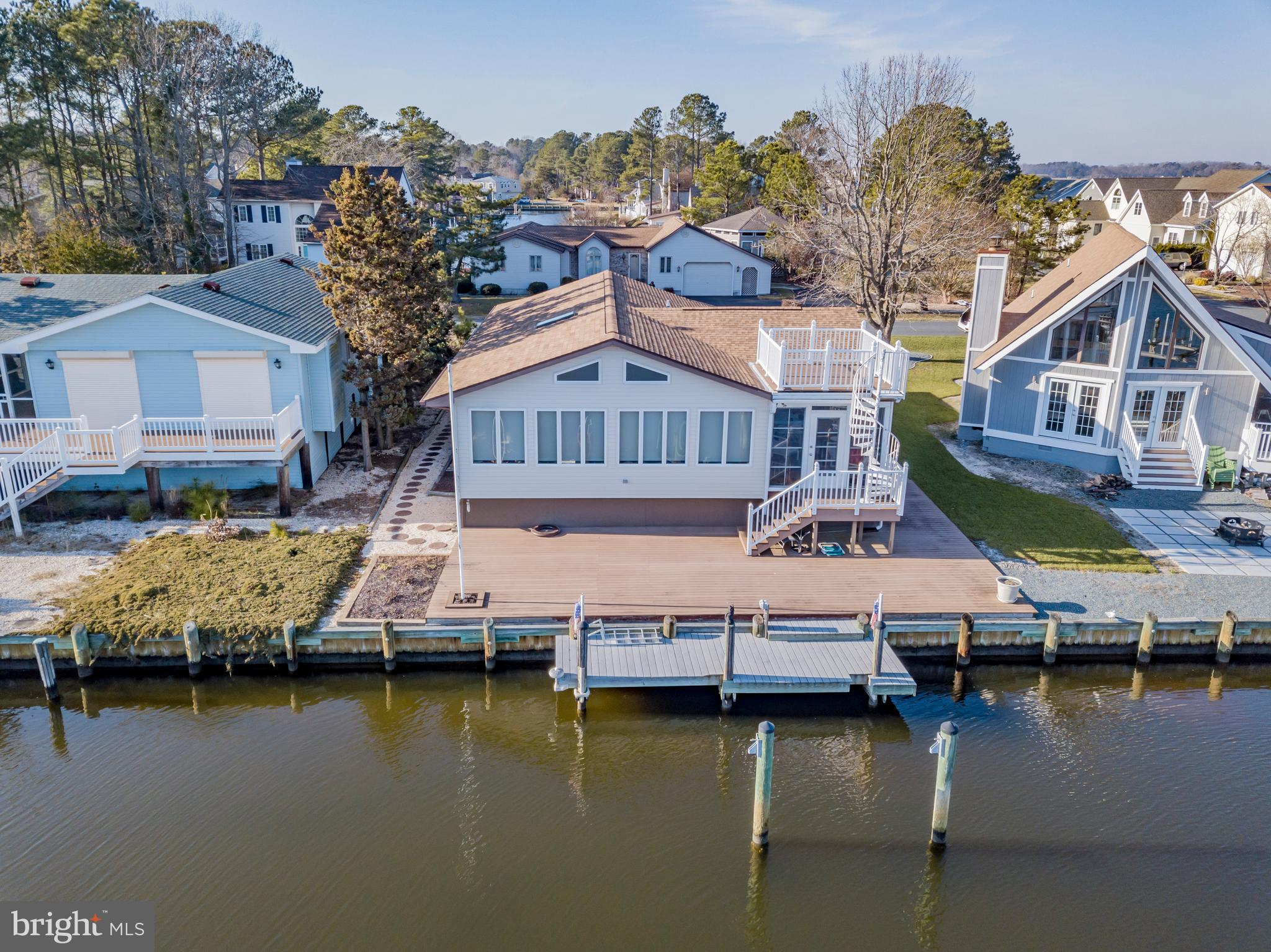 Custom-built coastal 1 level contemporary with easy access to River, Bay and Ocean. New roof in 2017