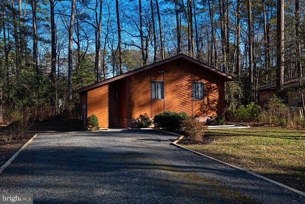 Relax and Enjoy this Cute-as-can-Be Rancher with Screened Porch and Deck without worrying about the