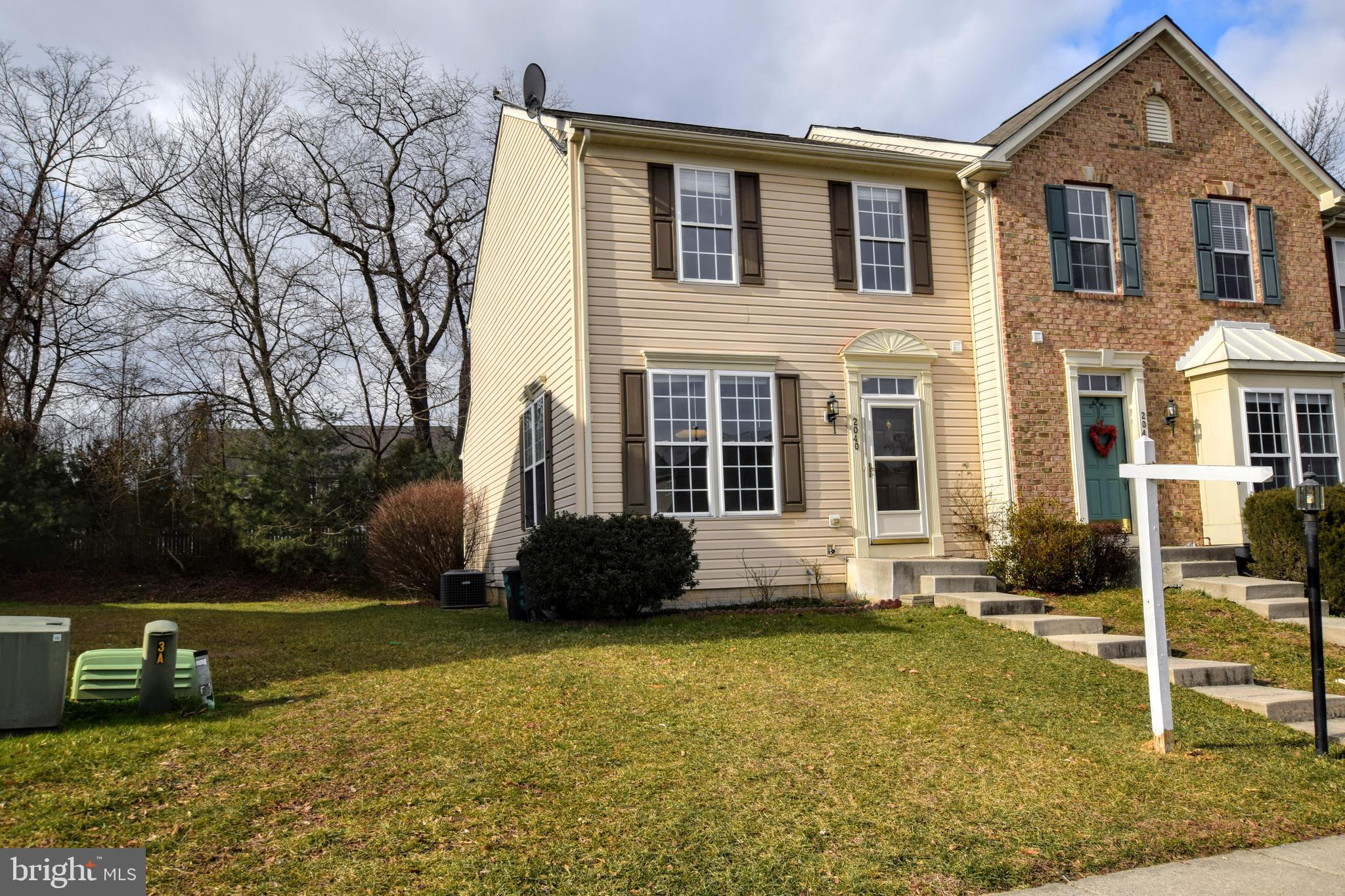 This is the one you've been waiting for! Incredible 3 BR 2 Full 2 Half Bath End-of-Group townhouse m