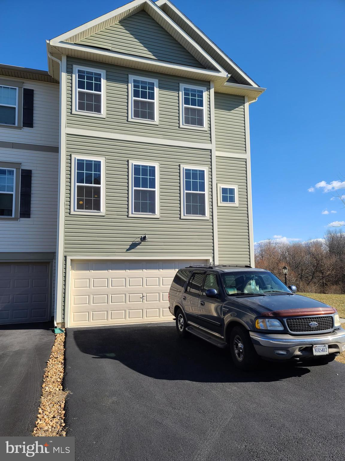 Much sought after End Unit Townhouse with Side Entry, Backs to parkland/trees/wooded area. 2-Car Att