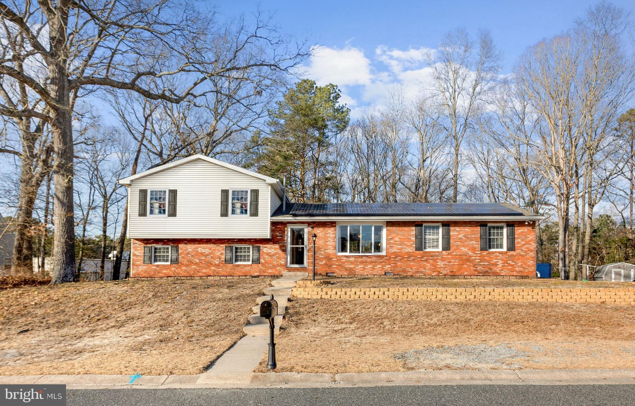 Charming RENOVATED split level in Forest Lake Estates boasting upgrades galore including NEW modern