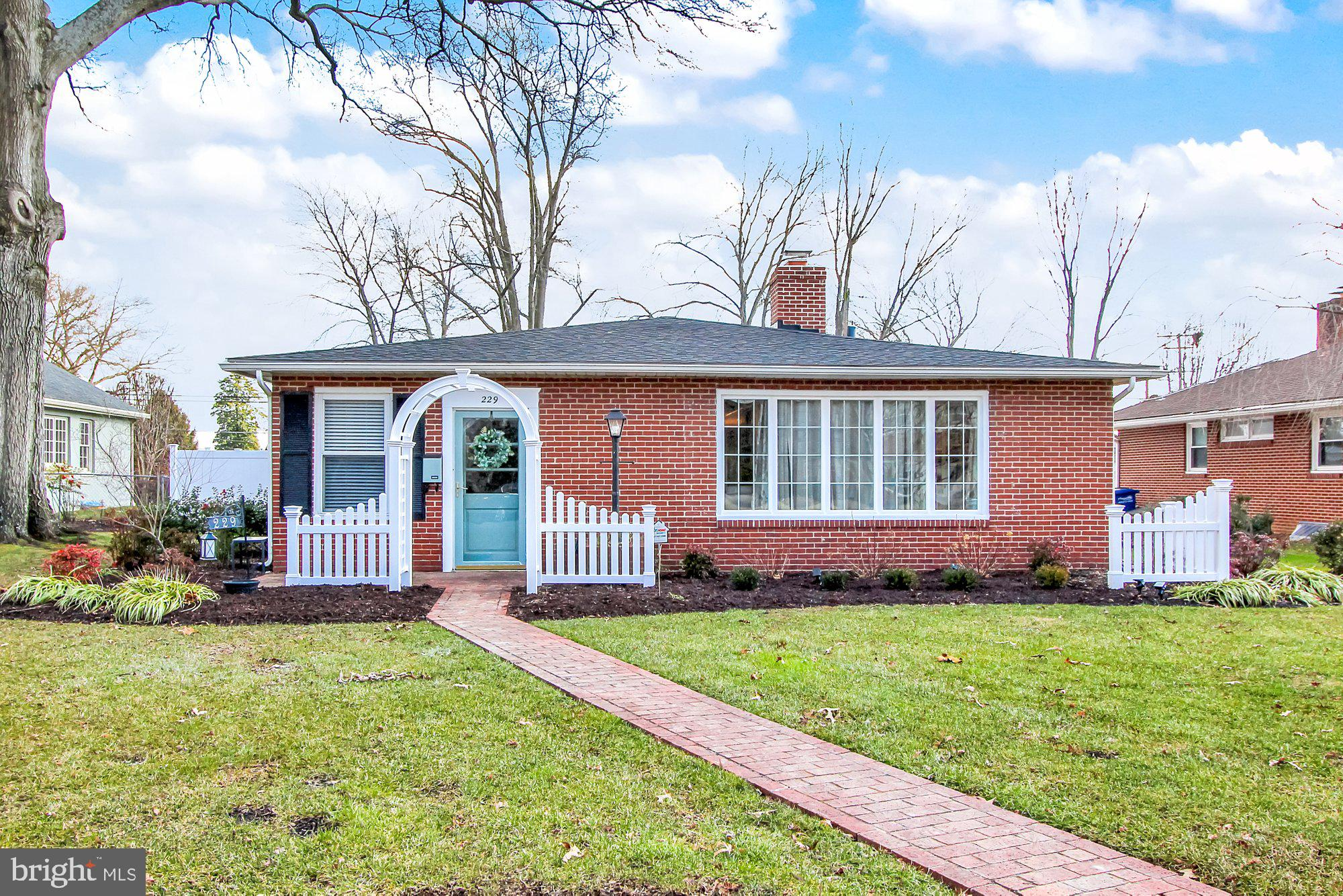 Beautiful brick rancher on a lovely tree lined street. Updated roof (2019) and gutter guards. Brick