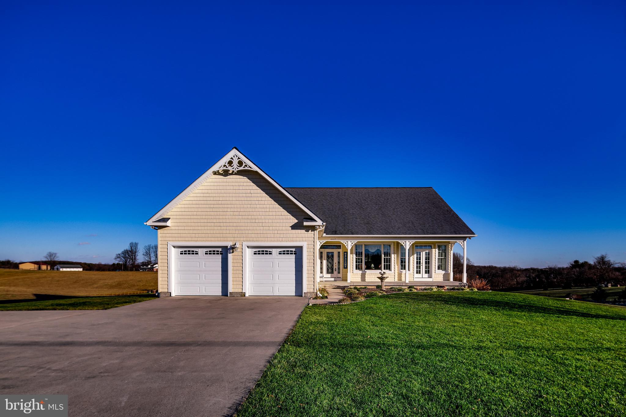 SPRAWLING RANCHER NOW AVAILABLE IN SOUGHT AFTER CARROLL COUNTY. THIS OUTSTANDING CUSTOM HOME BOASTS