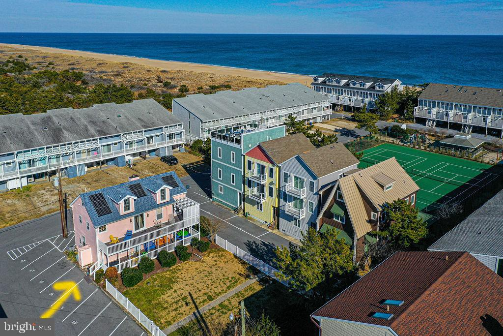 Major Price Reduction on this beautiful ocean block beach house in North Bethany Beach, DE offers a generous 2,261 sq. ft. floor plan with 4 bedrooms and 2.1 bathrooms. The welcoming front door is on a spacious porch which is ideal for outdoor entertaining. The first floor has a grand foyer that doubles as a dining area, an oversized living room with hardwood floors, efficient kitchen with granite countertops, and a primary bedroom and bath. On the second floor you will find an additional recreational area, sunroom, outdoor sun deck, and two bedrooms with a Jack and Jill bath. The top floor has an expansive bedroom space and a half bath. Natural light flows to the living areas through a wall of windows and glass sliders from the sun deck. Relax in comfort both inside and outdoors. Lots of outdoor deck space and an outdoor shower. Fun times can be had by all at the community beach maintained by the Tower Shores Beach Association. New roof in 2019. Excellent rental income potential. Low Ground Rent fee of $1,471 annually which is auto-renewed and has 61 years remaining. Flood and Hazard Insurance included in the condo fee.