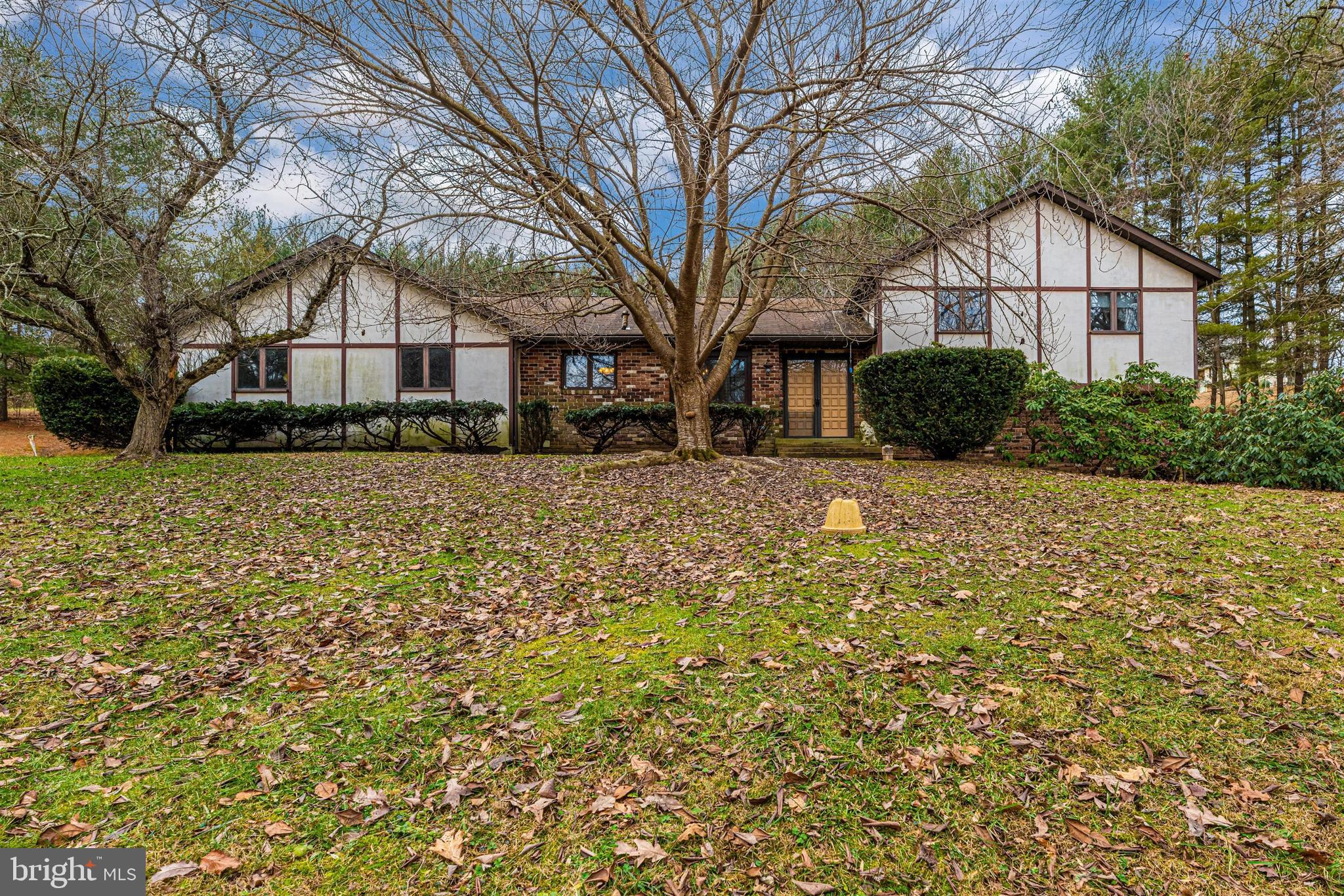 4 Bedroom, 3 Fullbath home on over 5 Private  Acres with a stream and mature trees.  Oversized 2 Car