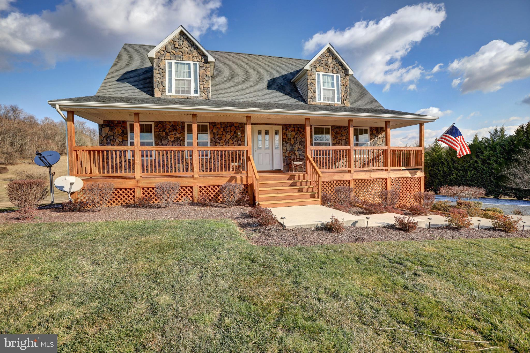 Absolutely stunning  River/Mountain views  from this Cape Cod resting on 2.75 Acres  in Crossings on