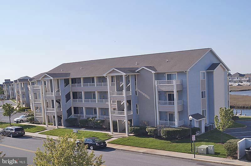 Excellent third floor unit in the premier Heron Harbour community.  Located directly on a bayside canal with views of the bay and Ocean City skyline. Amenities for owners include tennis courts, indoor and outdoor pools, fitness center, and much more. This well maintained unit has a long and well established rental history. Features include central air, full kitchen, two full bathrooms, off-street parking, and walking distance to the beach across Coastal Highway. One year Home Warranty provided at no cost to the buyer. Currently rented to a yearly tenant at $1145 per month. Buyer must honor existing lease that ends 2022-01-31. The condo association has increased the $1,100 quarterly condo fee by $1,924 per quarter for work needed on the buildings. Details attached to the listing. This  increase is for the next seven years. Seller is offering a qualified buyer up to a $15,000 credit toward this expense. The HOA assessment for the pools, amenities, etc remains at $225 per quarter. Buyers pay a one time HOA membership transfer fee of $600.