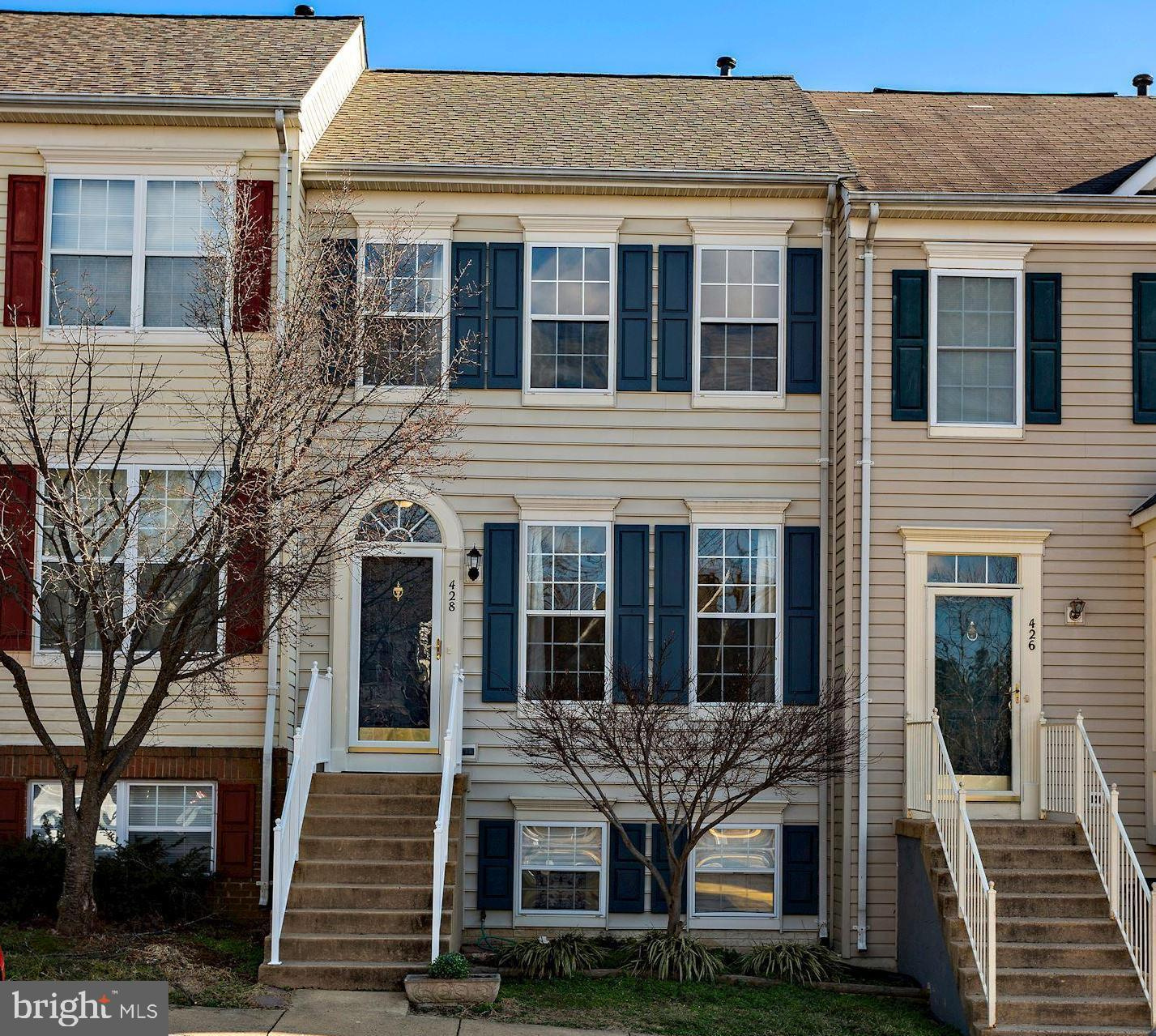 Spectacular  4 bedroom townhome located in the popular Sycamore Hill community just minutes from the Leesburg outlets, downtown and more!   This home is filled with loads of natural light while the main level showcases stylish wide plank hardwood floors, a gourmet kitchen w/ SS appliances and granite countertops.  Step off the kitchen to the expansive deck w/ staircase to lower level fenced in yard w/ private garden area.  Brand new carpet leads you upstairs to 3 bedrooms w/ updated bathrooms.  The walkout basement features the 4th bedroom, additional bathroom and versatile space, perfect for relaxation or exercise, whichever suits you!  New water heater, dishwasher, newer deck, fresh paint, new carpet throughout & more!  Hurry & see!  A+ Home & Location!