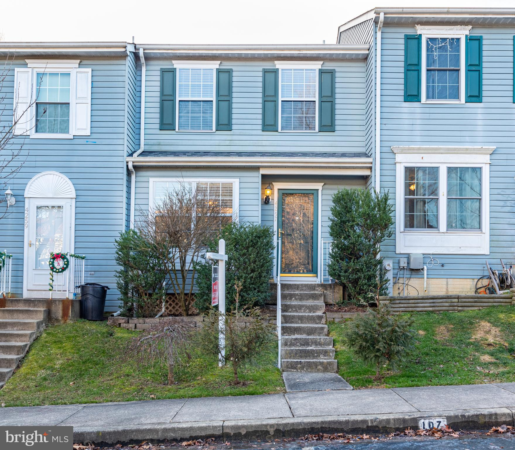 OPEN HOUSE SATURDAY 12-2.  Well-cared for spacious townhouse in walking distance to shopping. Conven