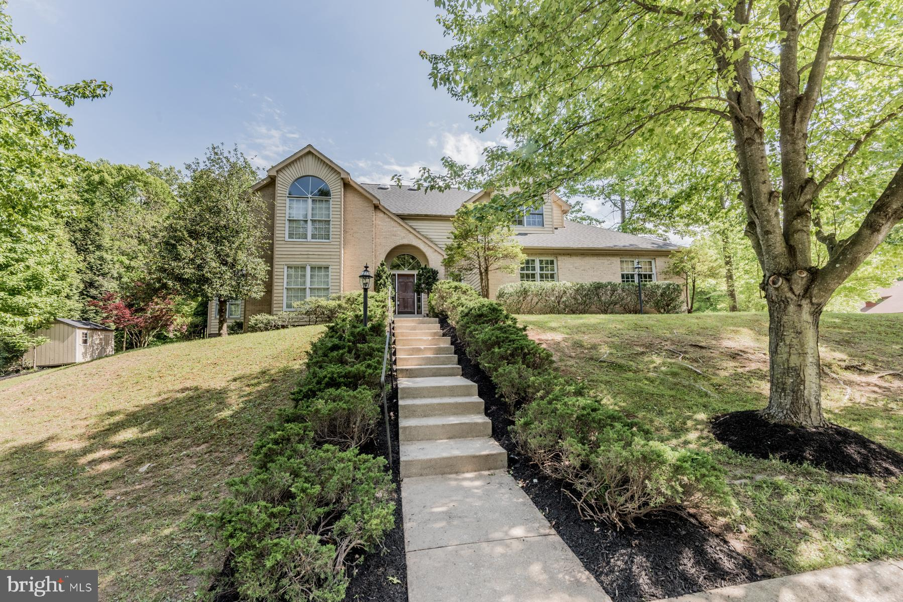 Fully remodeled home is perfectly set on a corner homesite in Owen Brown Woods! Fresh paint througho
